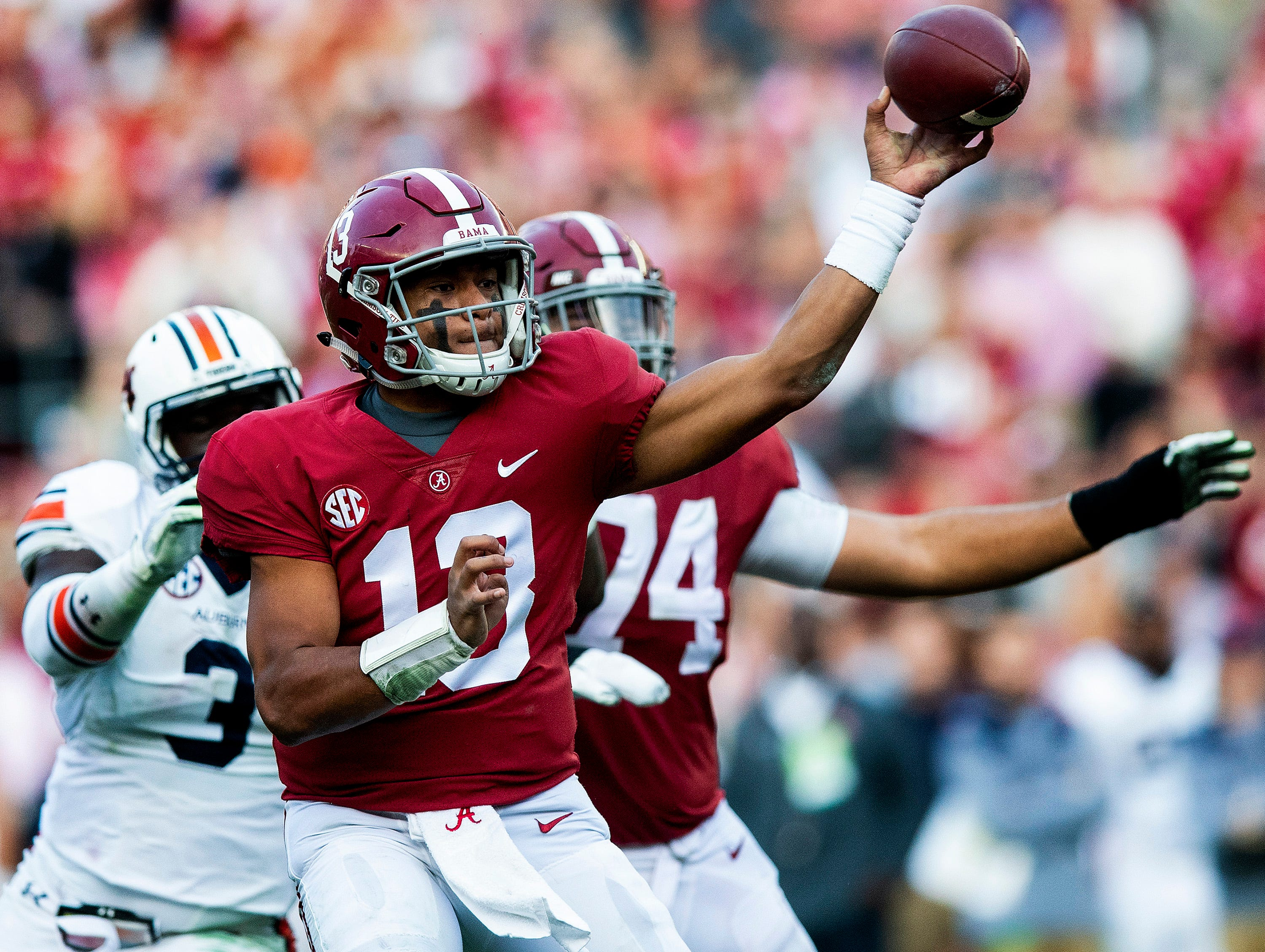 Alabama quarterback Tua Tagovailoa (13) passes against Auburn in first half action during the Iron Bowl at Bryant-Denny Stadium in Tuscaloosa, Ala., on Saturday November 24, 2018.