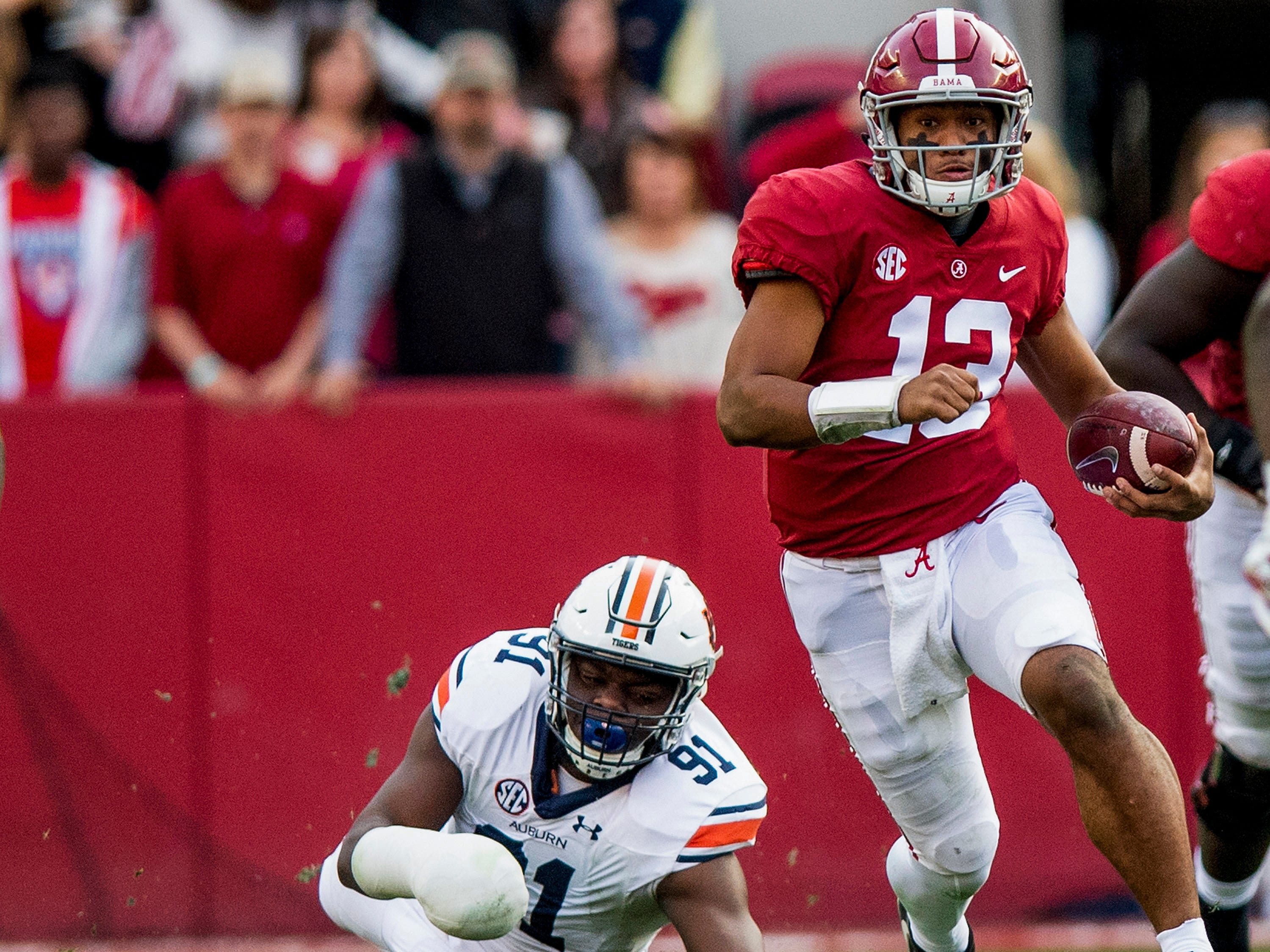 Alabama quarterback Tua Tagovailoa (13) carries the ball against Auburn in first half action during the Iron Bowl at Bryant-Denny Stadium in Tuscaloosa, Ala., on Saturday November 24, 2018.