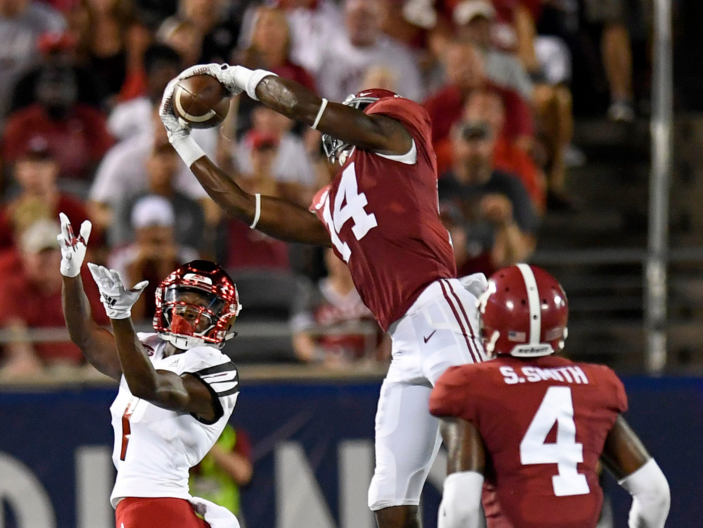 Alabama defensive back Deionte Thompson (14) intercepts a ball out of bounds against Louisville In first half action of the Camping World Kickoff at Camping World Stadium in Orlando, Fla., on Saturday September 1, 2018.