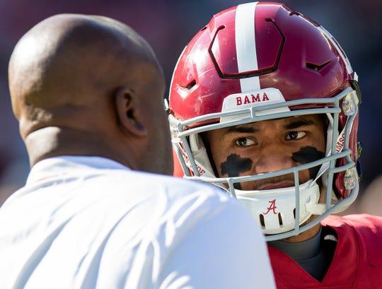 Alabama quarterback Tua Tagovailoa (13) talks with offensive coordinator Michael Locksley before the Alabama vs. Mississippi State game at Bryant Denny stadium in Tuscaloosa, Ala., on Saturday November 9, 2018.