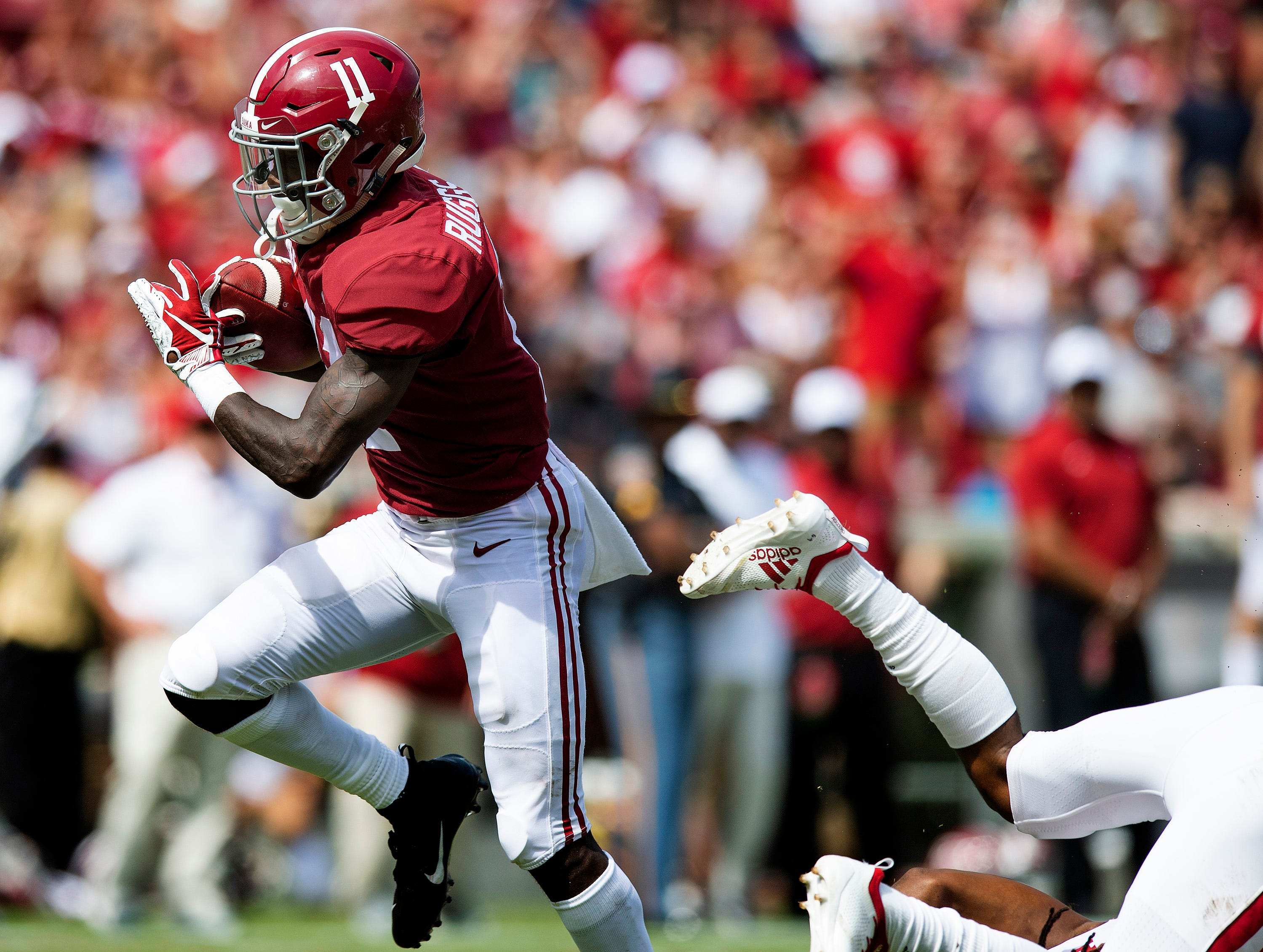 Alabama wide receiver Henry Ruggs, III, (11) breaks tackles against Louisiana on his way to his second touchdown in first half action at Bryant-Denny Stadium in Tuscaloosa, Ala., on Saturday September 29, 2018.