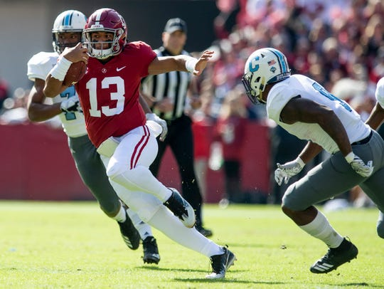 Alabama quarterback Tua Tagovailoa (13) carries the ball against The Citadel In first half action at Bryant-Denny Stadium in Tuscaloosa, Ala., on Saturday November 17, 2018.