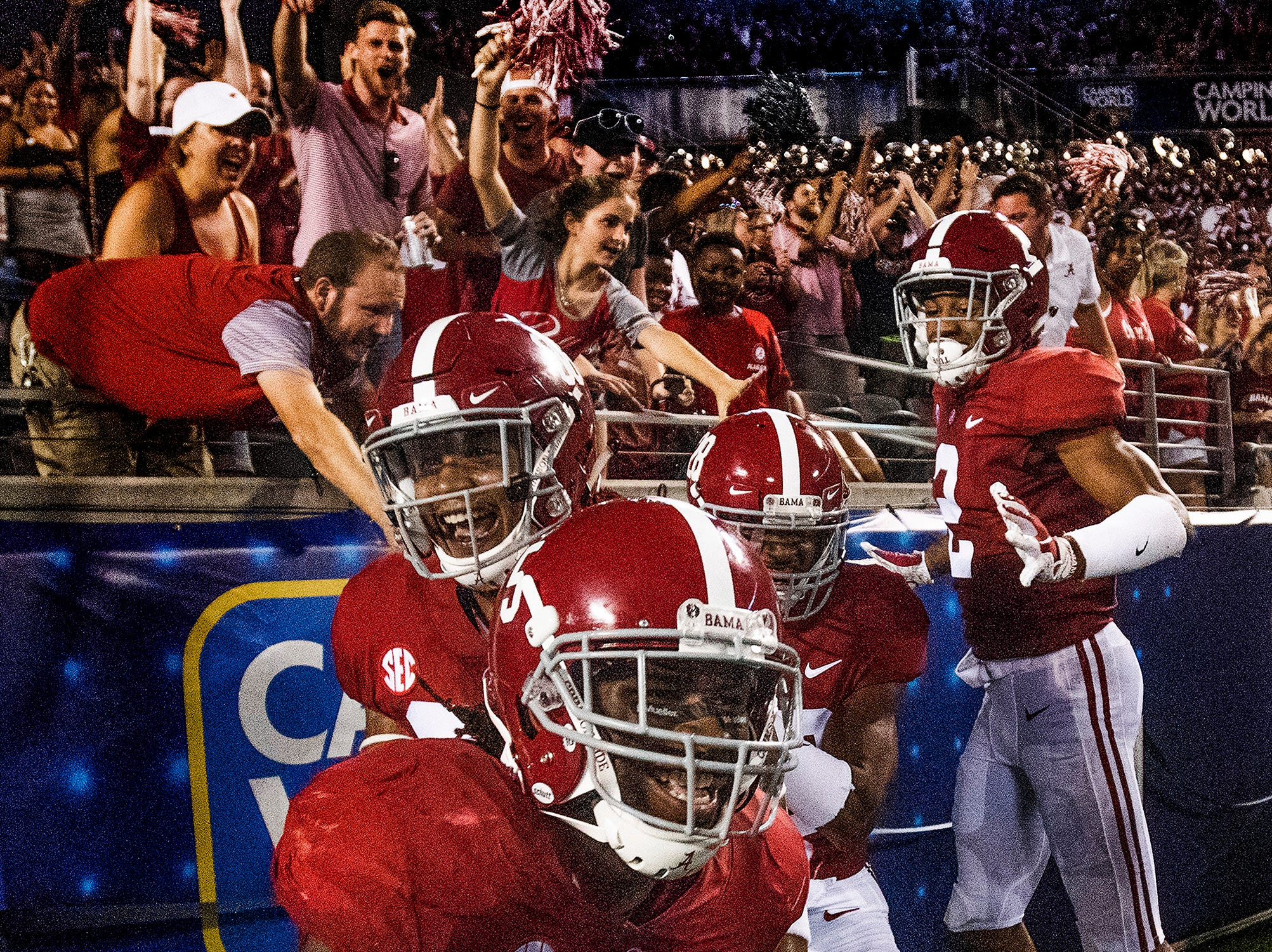 Alabama defensive back Shyheim Carter (5) celebrates with teammates and fans after intercepting a pass and returning it for a touchdown against Louisville In second half action of the Camping World Kickoff at Camping World Stadium in Orlando, Fla., on Saturday September 1, 2018.