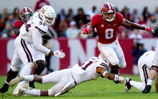 Alabama running back Josh Jacobs (8) is tripped up by Mississippi State safety Mark (41) in first half action at Bryant Denny Stadium in Tuscaloosa, Ala., on Saturday November 9, 2018.