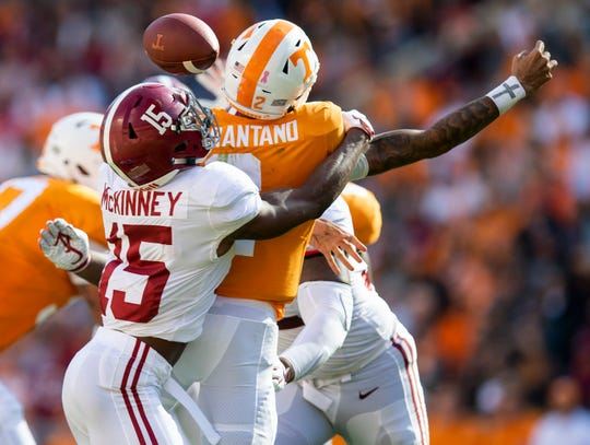 Alabama defensive back Xavier McKinney (15) hits Tennessee quarterback Jarrett Guarantano (2) causing a turnover in first half action at Neyland Stadium in Knoxville, Tn., on Saturday October 20, 2018.
