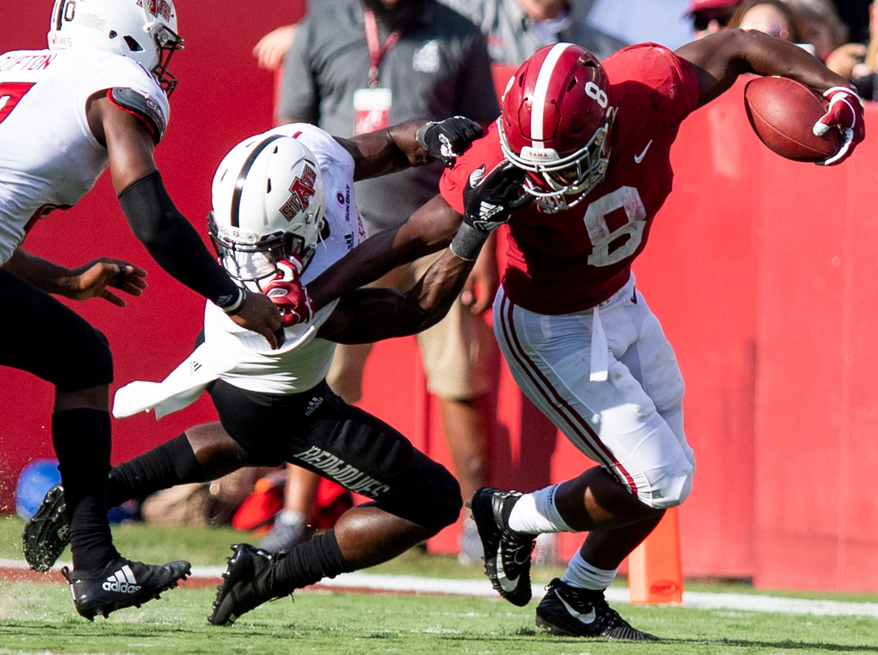 Alabama running back Josh Jacobs (8) is face masked by Arkansas State corner back Jerry Jacobs (1) in second half action at Bryant Denny Stadium in Tuscaloosa, Ala., on Saturday September 8, 2018.