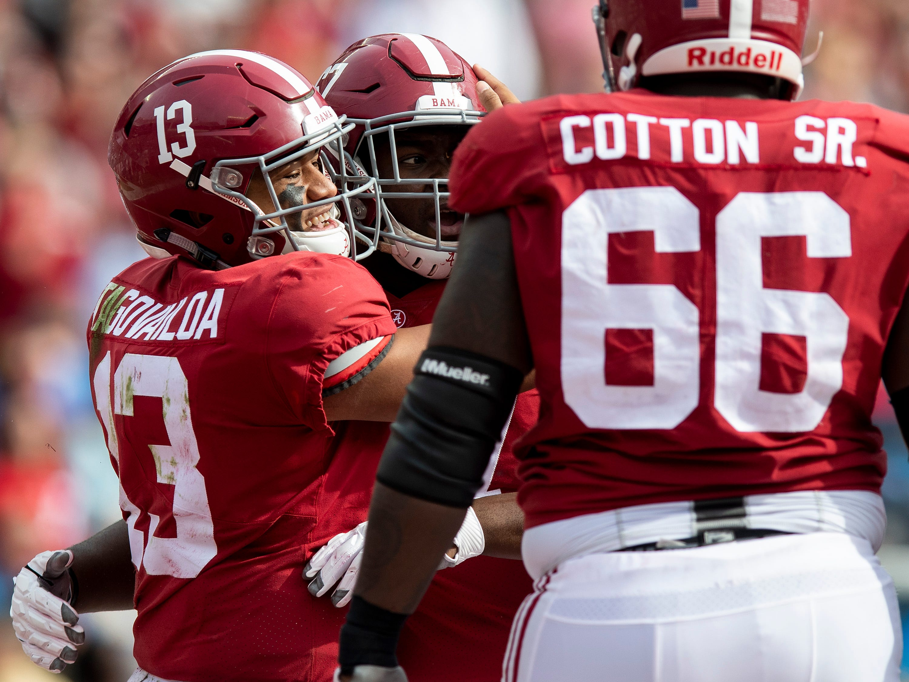 Alabama quarterback Tua Tagovailoa (13) hugs offensive lineman Josh Casher (67) after rushing for a touchdown against The Citadel in second half action at Bryant-Denny Stadium in Tuscaloosa, Ala., on Saturday November 17, 2018.