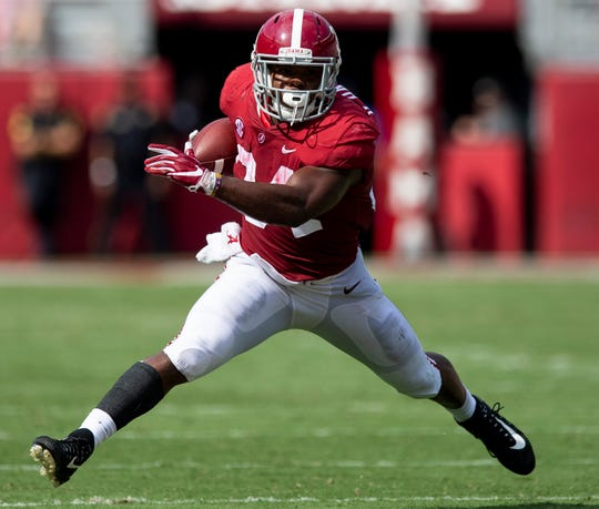 Alabama running back Damien Harris (34) carries against Arkansas State In first half action at Bryant Denny Stadium in Tuscaloosa, Ala., on Saturday September 8, 2018.