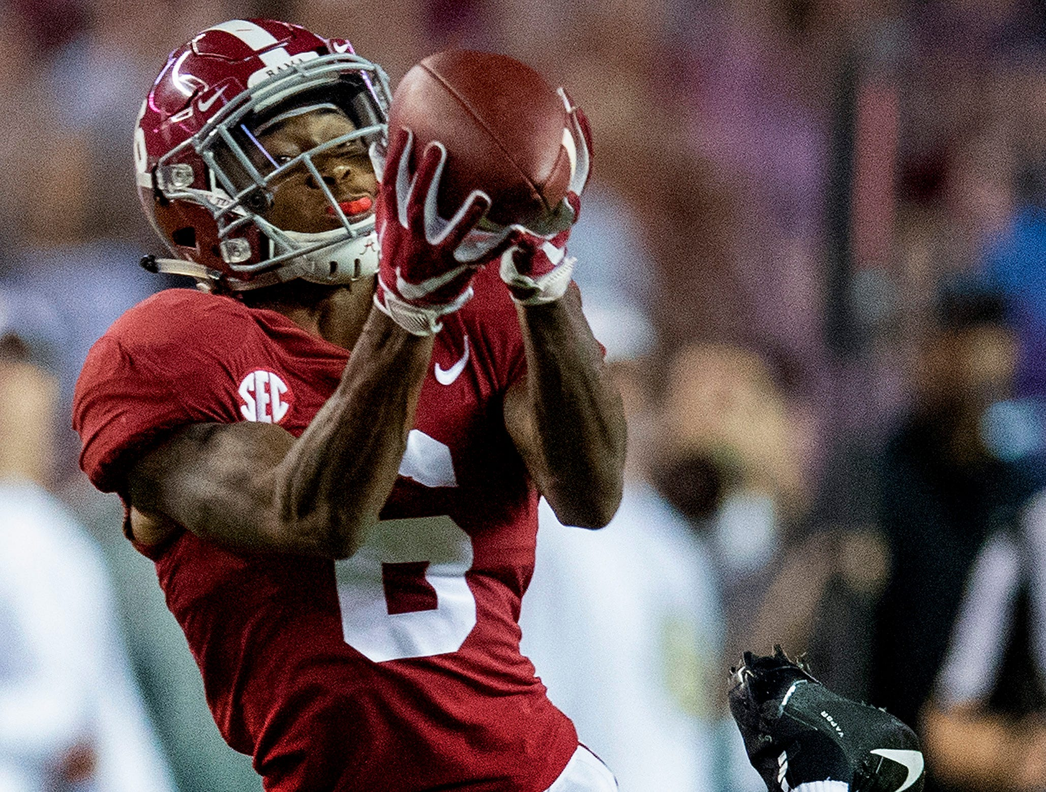 Alabama wide receiver DeVonta Smith (6) catches a p[ass against Missouri in first half action at Bryant Denny Stadium in Tuscaloosa, Ala., on Saturday October 13, 2018.