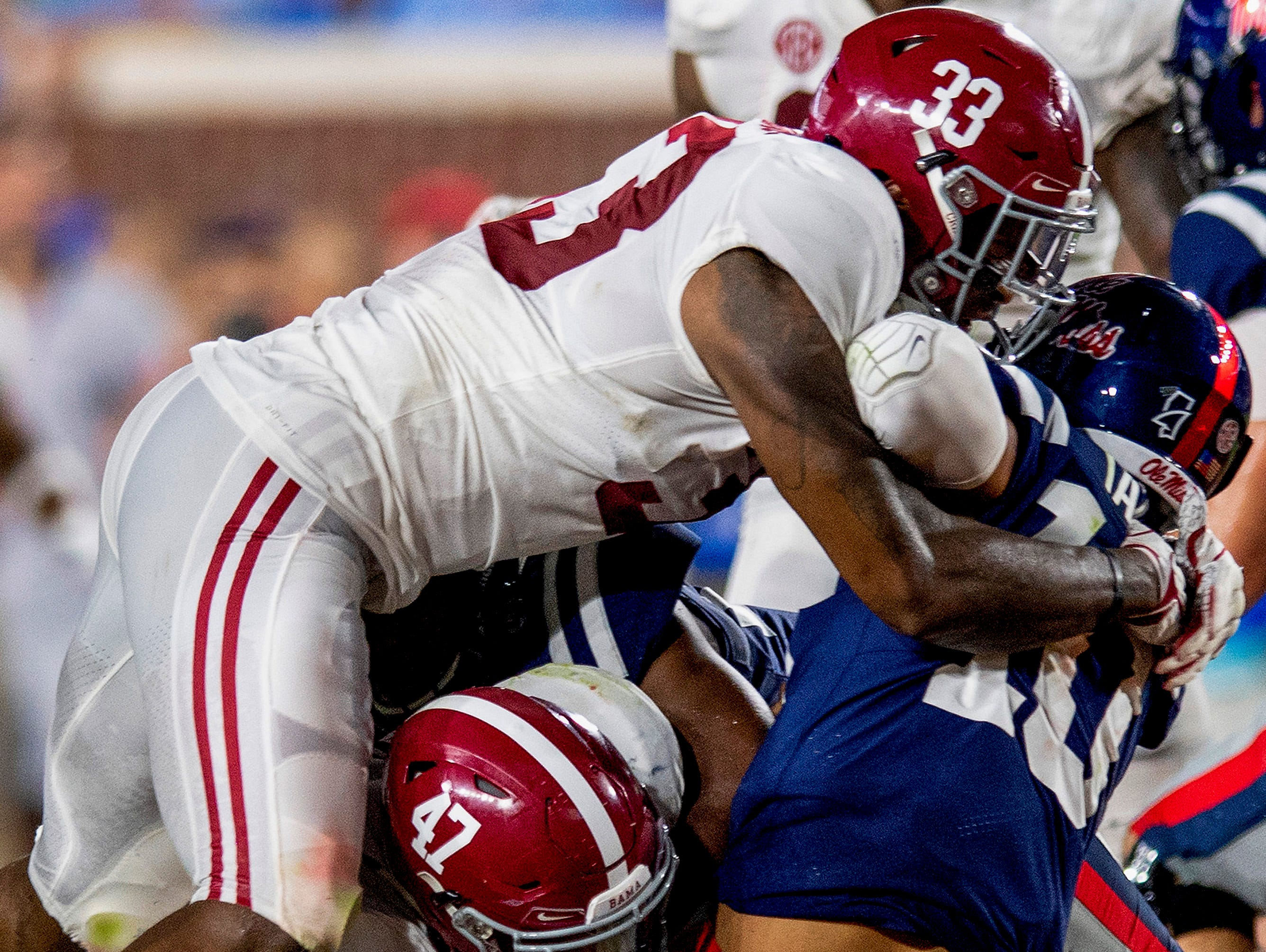 Alabama linebacker Christian Miller (47) and Alabama linebacker Anfernee Jennings (33) sack Ole Miss quarterback Jordan Ta'amu (10) on a fourth down play in first half action in Oxford, Ms., on Saturday September 15, 2018.