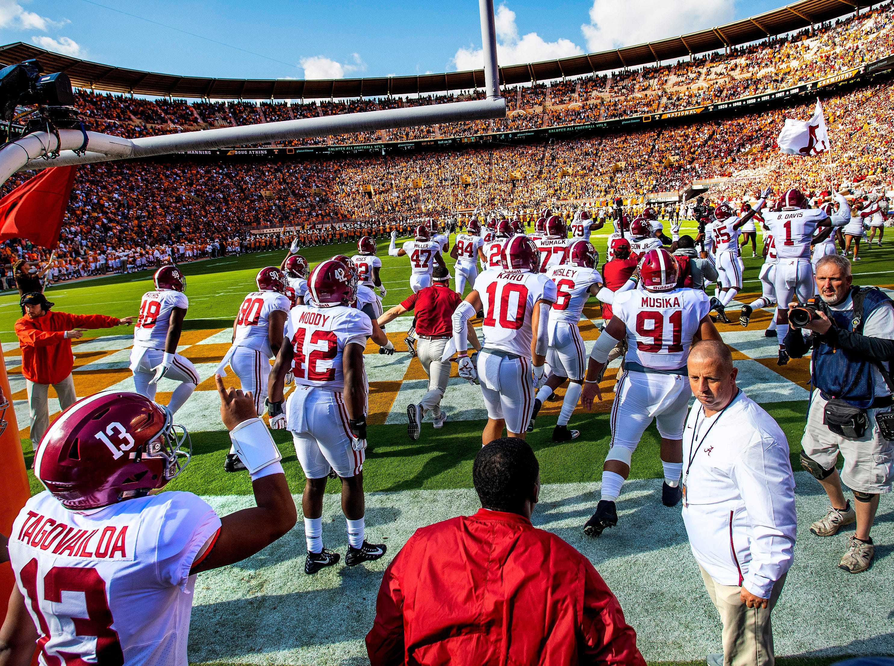 Alabama quarterback Tua Tagovailoa (13) signals number one as Alabama takes the field against Tennessee in first half action at Neyland Stadium in Knoxville, Tn., on Saturday October 20, 2018.