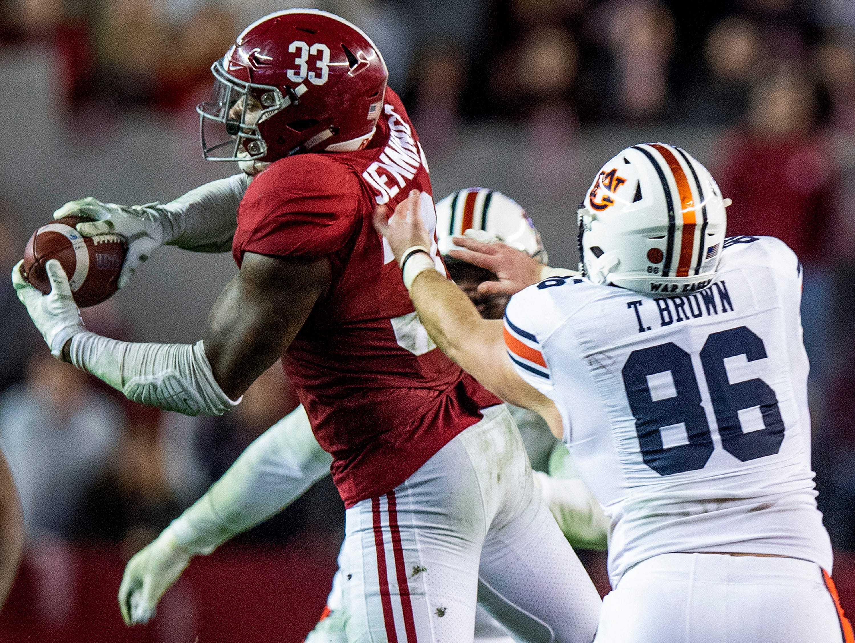Alabama linebacker Anfernee Jennings (33) intercepts a pass intended for Auburn tight end Tucker Brown (86) in second half action during the Iron Bowl at Bryant-Denny Stadium in Tuscaloosa, Ala., on Saturday November 24, 2018.