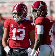 Alabama quarterback Tua Tagovailoa (13) and wide receiver Jerry Jeudy (4) talk before the Alabama vs. Mississippi State game at Bryant Denny stadium in Tuscaloosa, Ala., on Saturday November 9, 2018.
