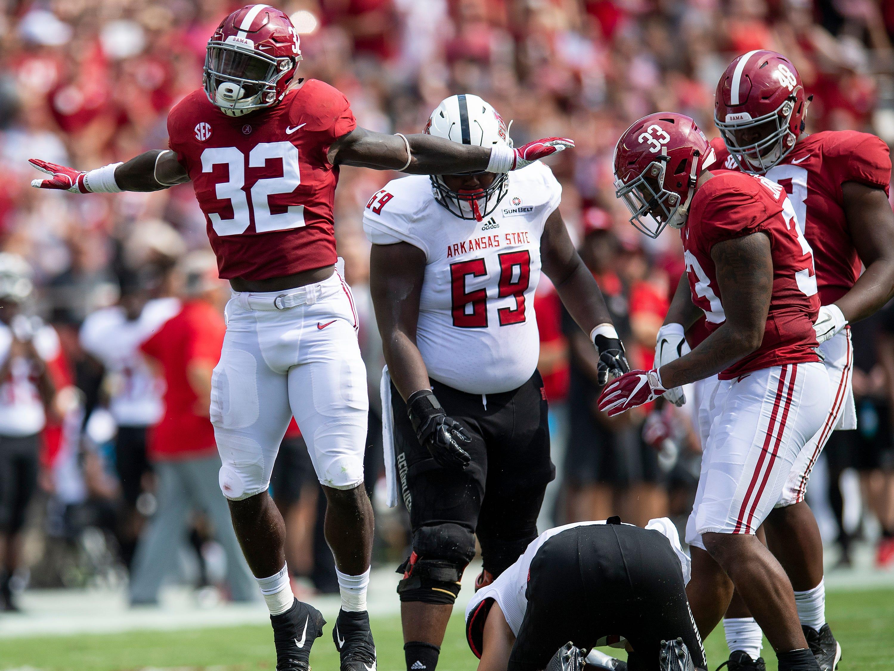 Alabama linebacker Dylan Moses (32) celebrates a sack of Arkansas State quarterback Justice Hansen (15) In first half action at Bryant Denny Stadium in Tuscaloosa, Ala., on Saturday September 8, 2018.