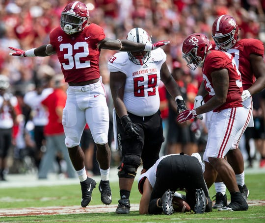 Alabama linebacker Dylan Moses (32) celebrates a sack of Arkansas State quarterback Justice Hansen (15) In first half action at Bryant Denny Stadium in Tuscaloosa, Ala., on Saturday September 8, 2018.