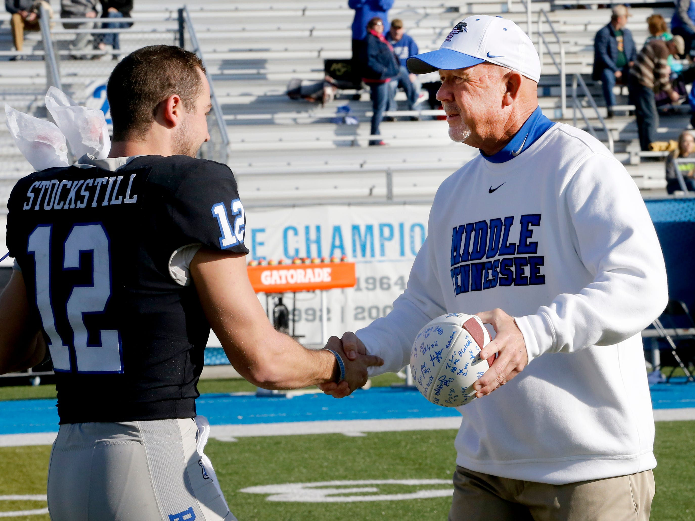 MTSU head football coach Rick Stockstill greats his son and MTSU quarterback Brent Stockstill as Brent Stockstill is honored with the other senior football players on Senior Day, before the start of the game against UAB at MTSU, on Saturday, Sept. 29, 2018.