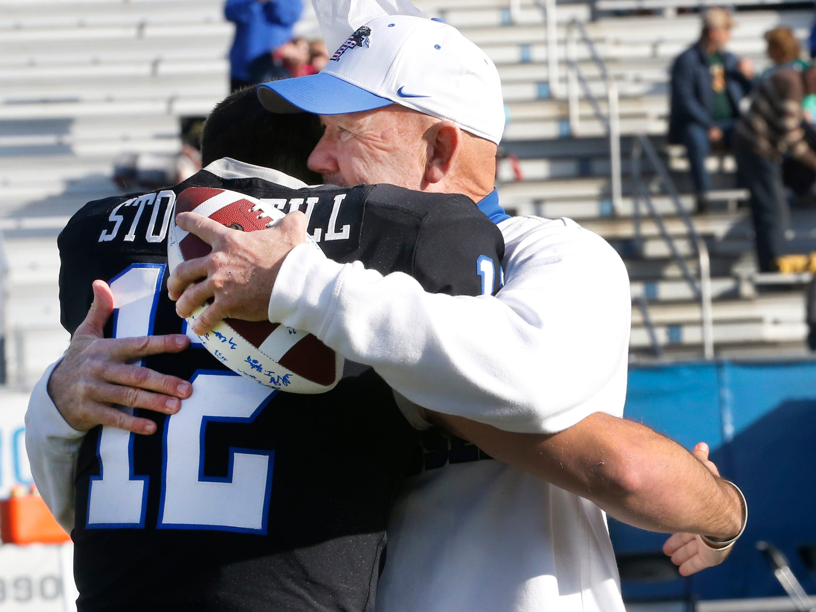 MTSU head football coach Rick Stockstill hugs his son and MTSU quarterback Brent Stockstill as Brent Stockstill is honored with the other senior football players on Senior Day, before the start of the game against UAB at MTSU, on Saturday, Sept. 29, 2018.