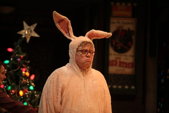 "Veteran Nashville actor Derek Whittaker dons the pink bunny suit and glasses as Ralphie for his fourth year in Nashville Rep's final production of ""A Christmas Story."""