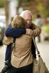 Don Beisswenger, a retired professor of Vanderbilt University, gets a hug from his friend Joyce Perkins in front of the Nashville Peace and Justice Center on Sept. 30, 2004. He was released from the federal prison in Manchester, Ky., after spending six months for trespassing on federal property in Fort Benning, Ga.