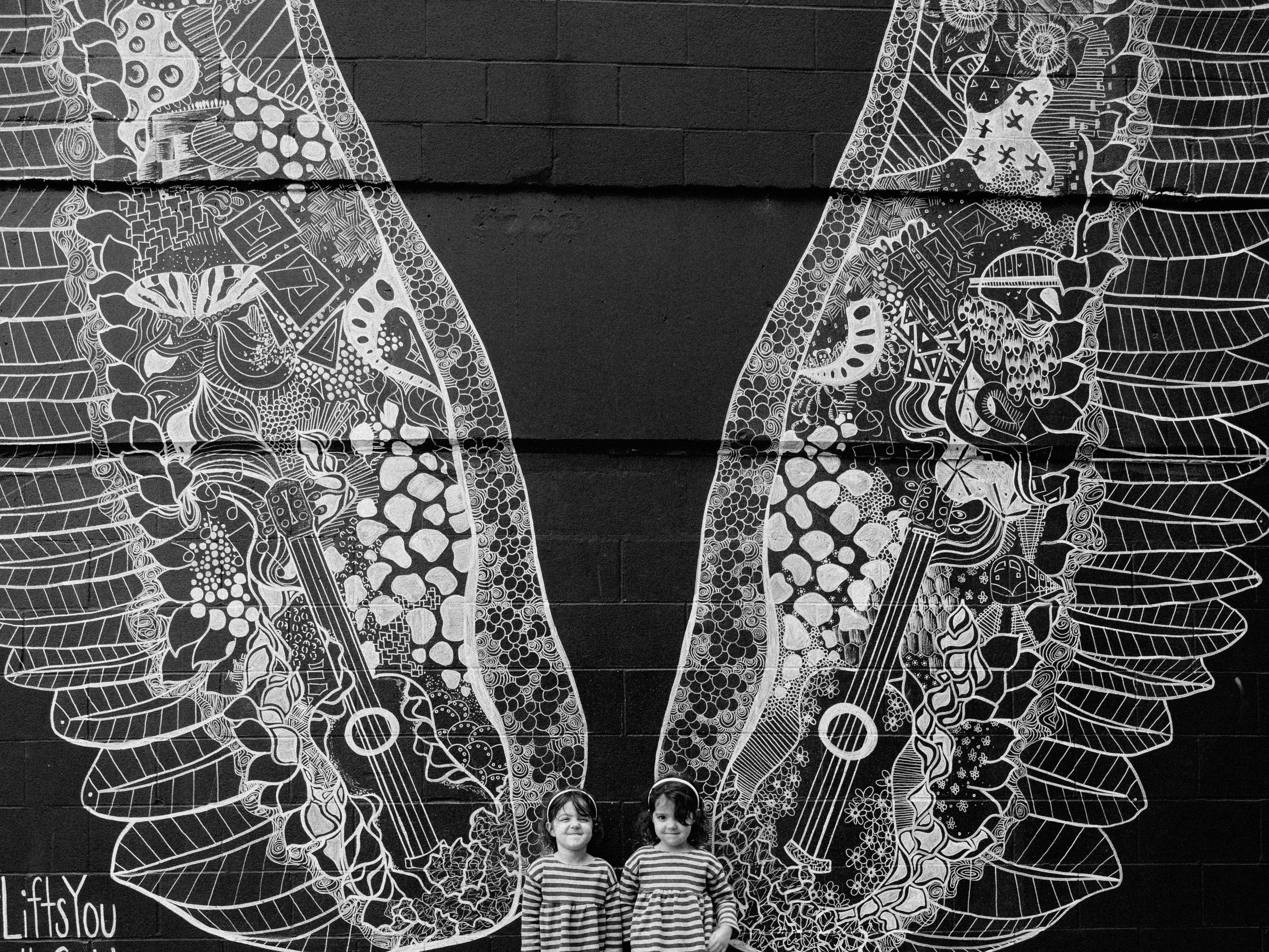 Kelsey Montague painted these twenty-foot-tall wings on the side of a building in the Gulch. ... It's called What Lifts You, and it does.