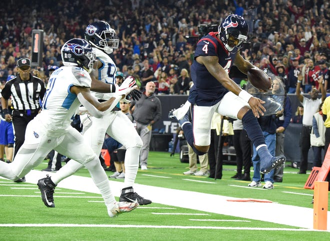 Texans quarterback Deshaun Watson (4) leaps into the endzone for a touchdown in front of Titans safety Kevin Byard (31) and linebacker Brian Orakpo (98) in the second quarter at NRG Stadium Monday, Nov. 26, 2018, in Houston, Texas.