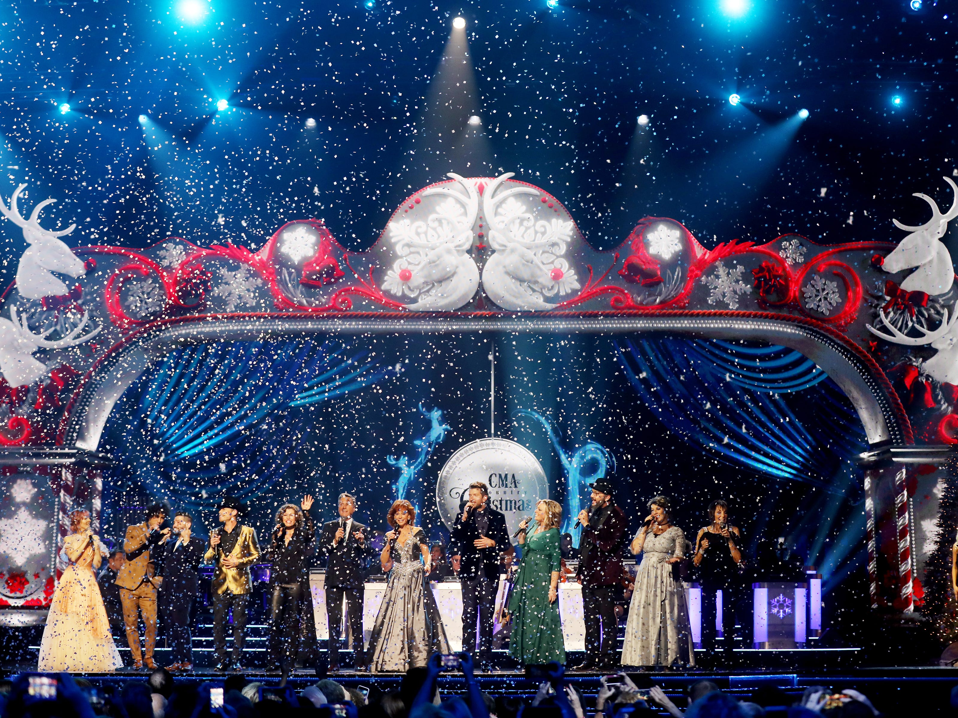 Reba McEntire is joined on stage by many of the performers for a final song during the filming of the 2018 CMA Country Christmas Thursday September 27, 2018 at Belmont's Curb Event Center.