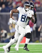 Titans tight end Jonnu Smith (81) races up the first with a touchdown catch in the first quarter at NRG Stadium Monday, Nov. 26, 2018, in Houston, Texas.