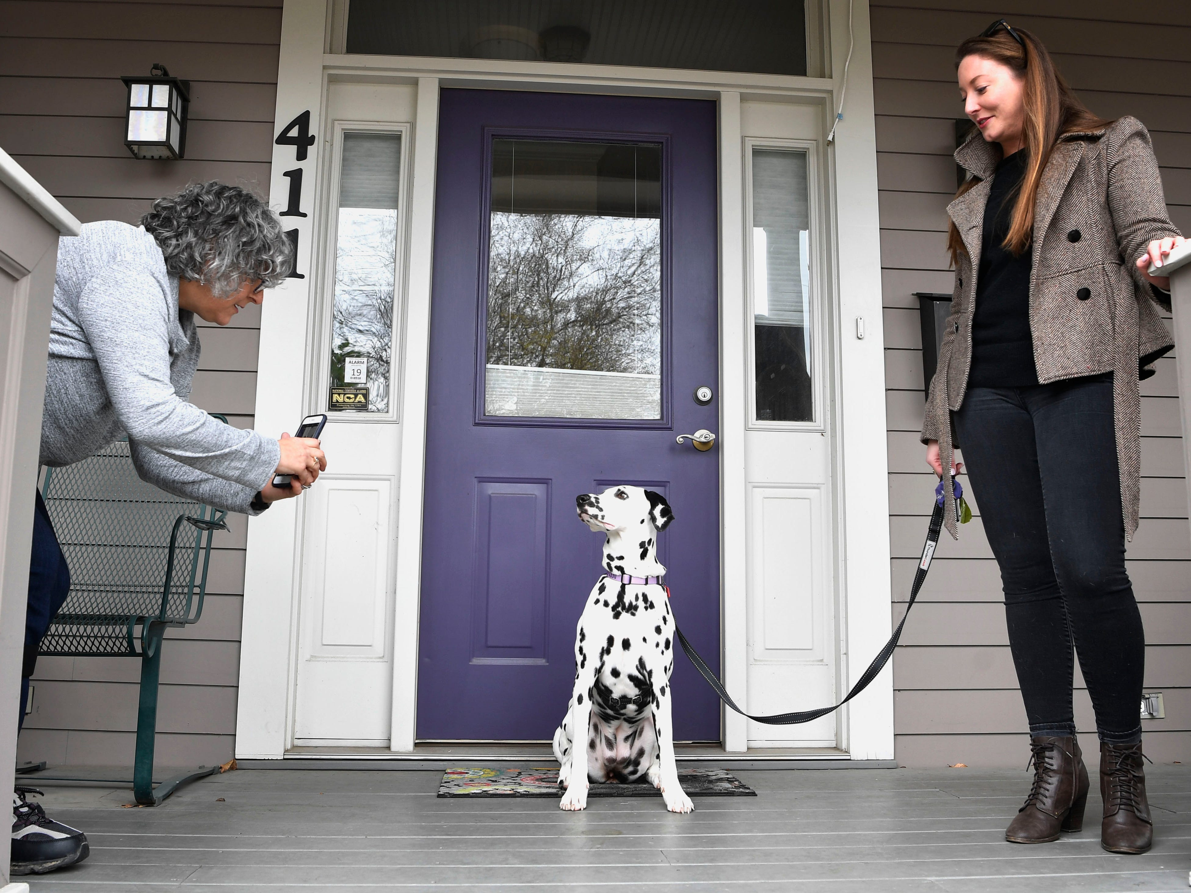 "Sheila Cope, who runs the popular Instagram account ""Germantown Dogs,"" takes a photo of ""Dottie"" as Liz Zipperer looks on.