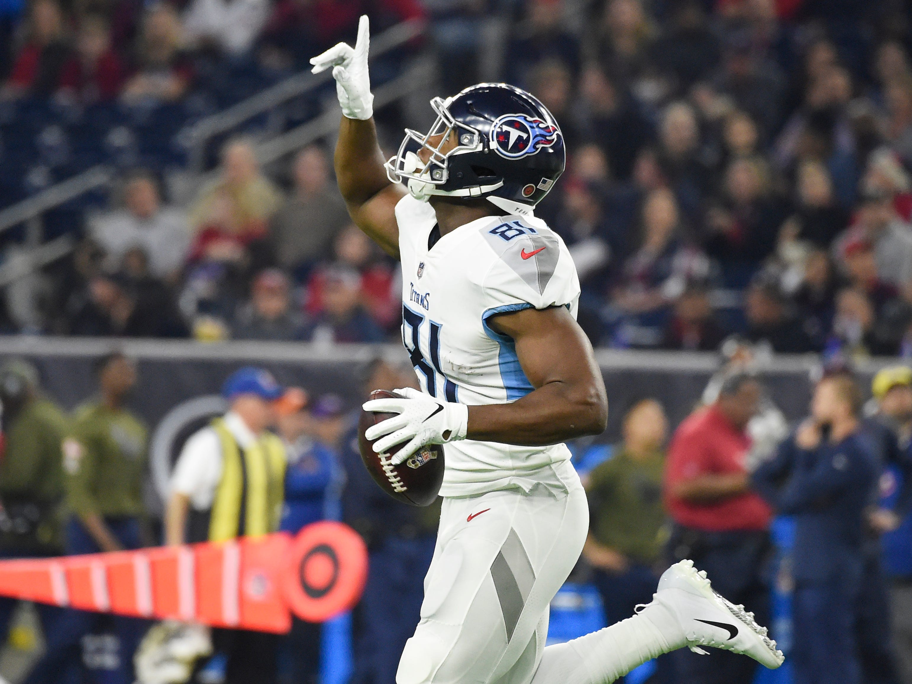 Titans tight end Jonnu Smith (81) celebrates his touchdown in the first quarter at NRG Stadium Monday, Nov. 26, 2018, in Houston, Texas.