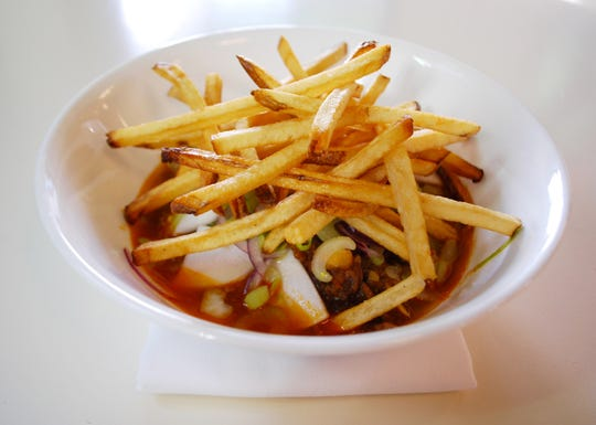 Lemongrass beef stew with hakurei turnips and crispy fries at Mop/Broom Mess Hall.