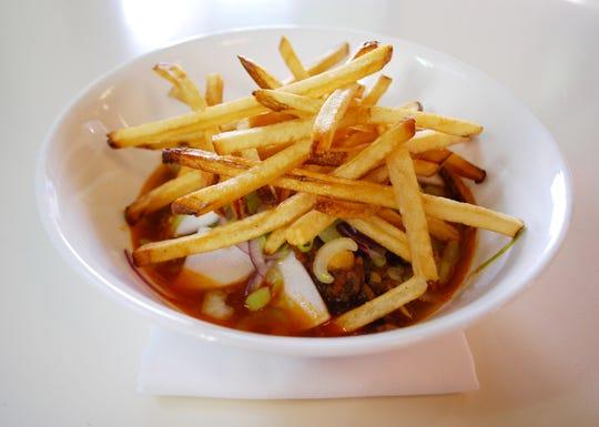 Lemongrass beef stew with hakurei turnips and crispy fries at Mop/Broom Mess Hall.
