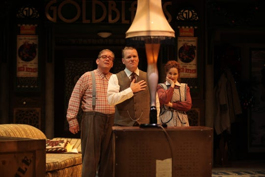 "Derek Whittaker, left, returns for his fourth year as Ralphie, while real-life husband and wife Jack E. Chambers and Meghan Murphy Chambers portray Ralphie's father and mother in Nashville Rep's final production of ""A Christmas Story."""