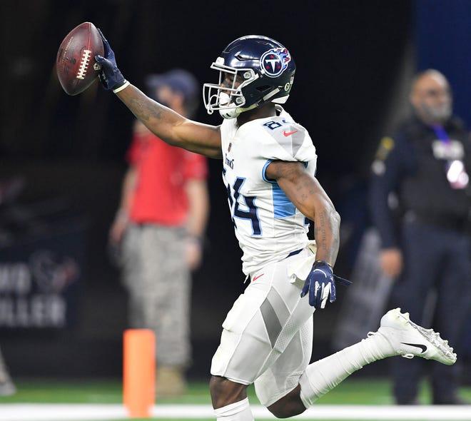 Titans wide receiver Corey Davis scores in the third quarter Monday.