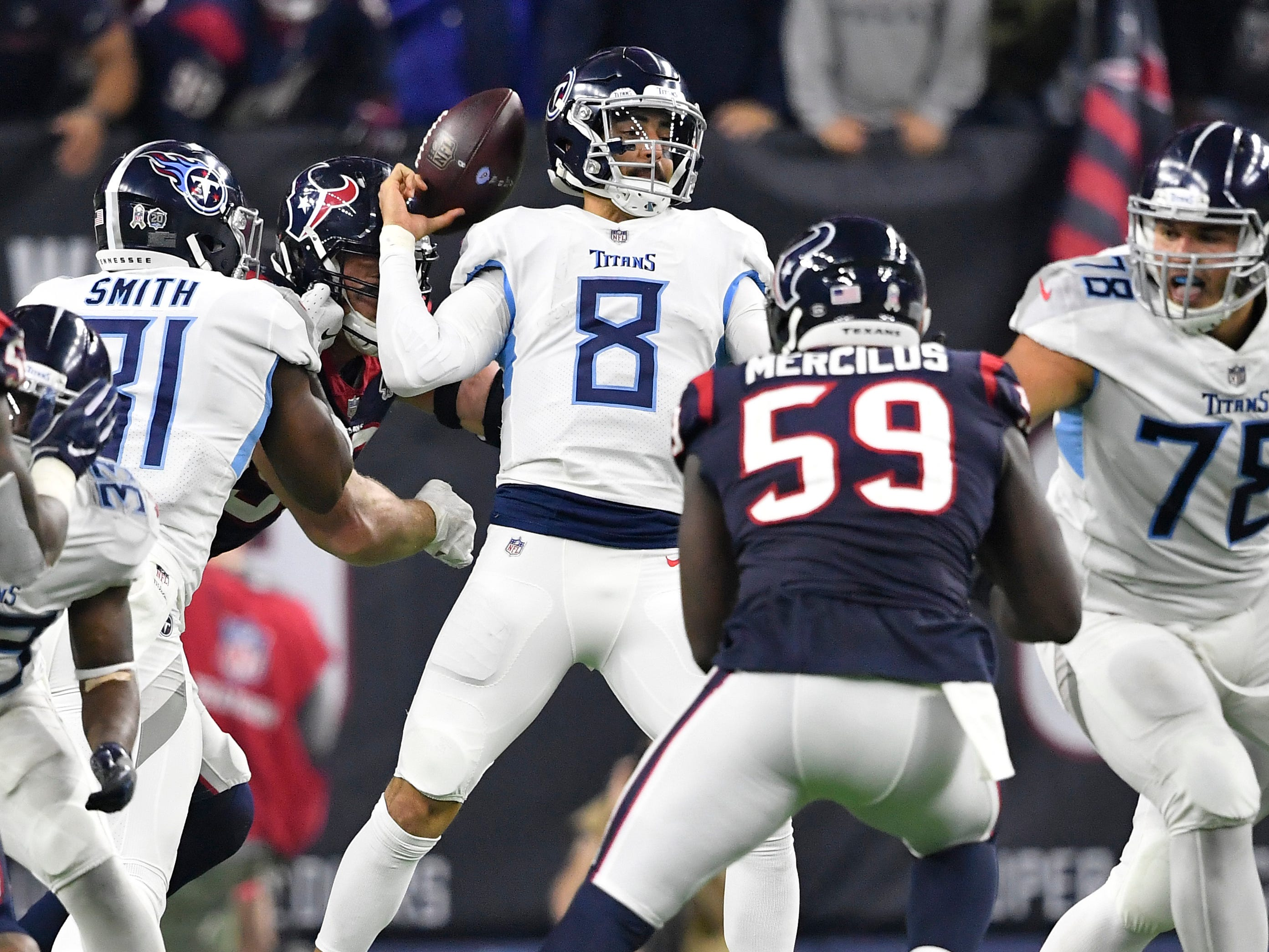 Titans quarterback Marcus Mariota (8) loses the ball when sacked by Texans defensive end J.J. Watt (99) in the fourth quarter at NRG Stadium Monday, Nov. 26, 2018, in Houston, Texas.