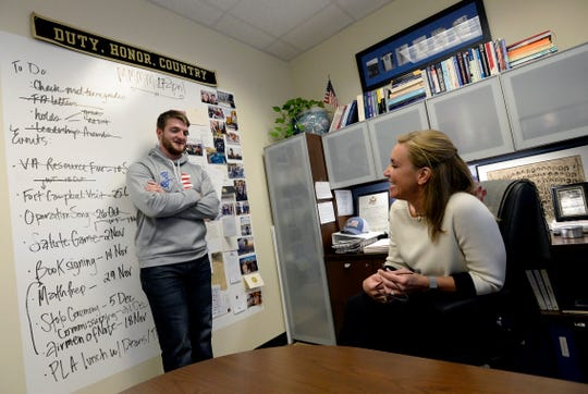 Middle Tennessee State University Veterans and Military Family Center director, Dr. Hilary Miller talks with geo science student and former United State Marine Corps Sgt. Brandon Watts, 25, in her office on Monday, Nov. 26, 2018, in Murfreesboro, Tenn. Miller works with veteran students on the GI Bill who haven't received their benefits for months due to VA technical difficulties.