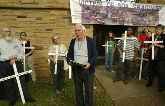 Don Beisswenger, a retired Vanderbilt University professor, speaks in front of his supporters and friends on the front lawn of the Nashville Peace and Justice Center on Sept. 30, 2004. He was released from federal prison in Manchester, Ky., after spending six months for trespassing on federal property in Fort Benning, Ga.