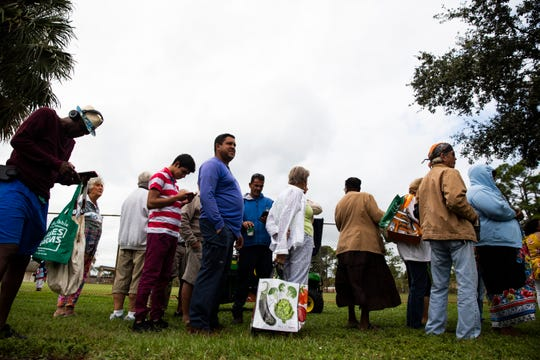 More than 100 people gather at East Naples Community Park on Tuesday, Nov. 27, 2018, for the Harry Chapin Mobile Food Pantry produce distribution.