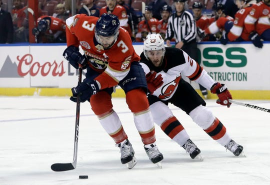 Florida Panthers defenseman Keith Yandle (3) skates with the puck as New Jersey Devils right wing Stefan Noesen defends during the first period of an NHL hockey game, Monday, Nov. 26, 2018, in Sunrise, Fla.