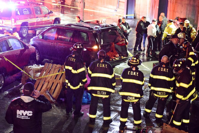 Police at the scene where six people were injured and one was killed after being struck by a van at about 7 p.m. Monday on Forsyth Street near Canal Street in New York.