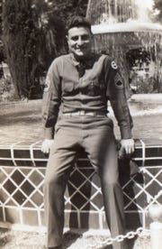 Peter Jacullo poses for a photo in his army uniform during World War II.