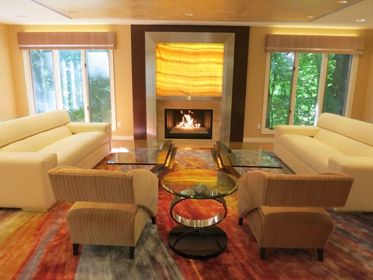 This Englewood home features a custom-designed fireplace by Ron Nathan Interiors in Wyckoff.