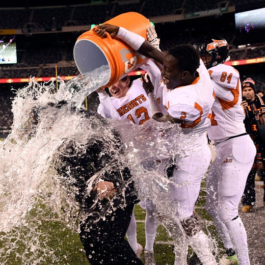 Hasbrouck Heights players dump water on their head coach Nick Delcalzo during their 41-7 win over Butler in the North Group 1 final on Friday, Nov. 23, 2018, in East Rutherford. (Danielle Parhizkaran/@danielleparhiz)