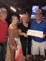 The Olson family celebrates Matt's birthday, far right, including his son Ryan, far left, daughter Molly and wife Patty.