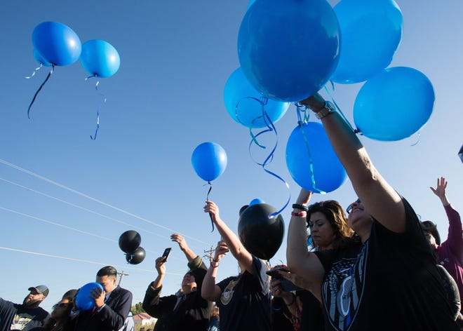 Friends, family and Las Cruces Police officers gathered at the site where JR Stewart, a retired LCPD officer, was killed a year ago to have a memorial service and release 141 balloons, the number on Stewart's badge, Tuesday November 26, 2018. Stewart was killed by a driver attempting to escape police during a 2017 high-speed pursuit.