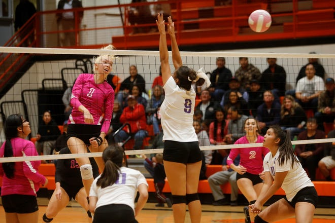 Aztec's Reigan Weaver watches her kill attempt fly past Kirtland Central's Siigrid Lii'bilnaghahi (9) during a District 1-4A match on Oct. 11 at Lillywhite Gym in Aztec. Weaver was named All-District co-player of the year.