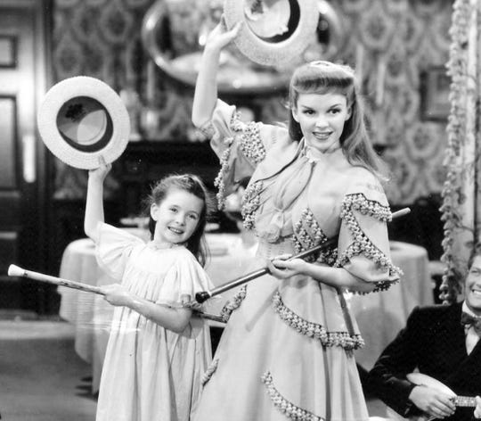 "Margaret O'Brien and Judy Garland in a 1944 MGM publicity still for ""Meet Me In St Louis."""
