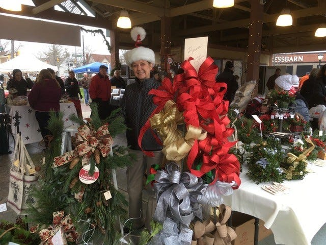 """Tracy Freeman of Farmington is all smiles at the farmers market, participating in downtown's annual spectacular, """"Holly Days."""""""