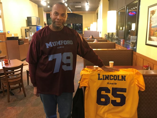 Mike Williams is a Detroit Mumford graduate who is trying to launch a museum of high school memorabilia. Also shown is a replica jersey of the defunct Ferndale Lincoln High School.