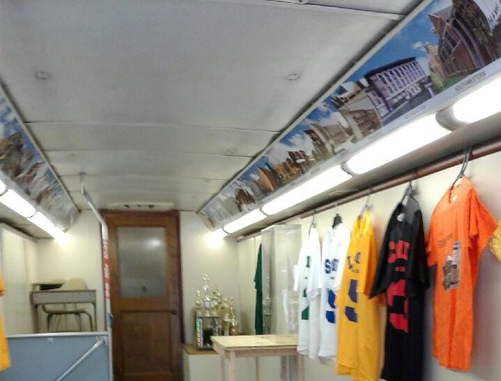 The interior of a 35-foot former SMART bus that Mike Williams is repurposing for a mobile museum of high school artifacts.