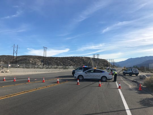Palm Springs police block Indian Canyon Drive after a driver and pedestrian were killed in a collision Tuesday.